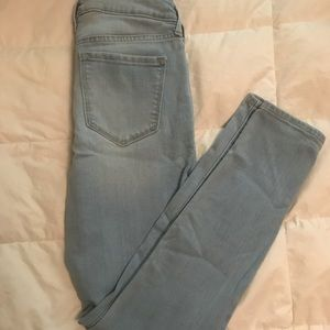 mid-rise light wash jeans.